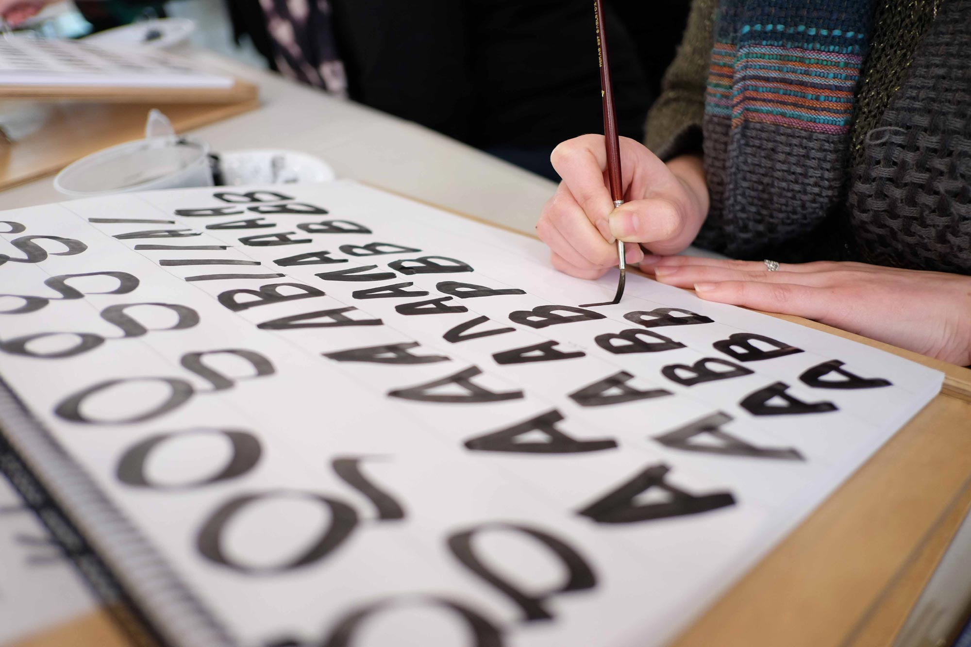 Student practicing brush lettering